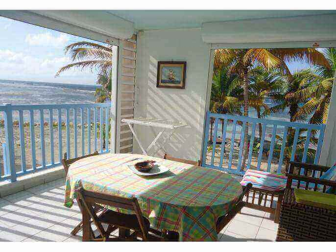 Location Appartement Guadeloupe - salle à manger vue mer