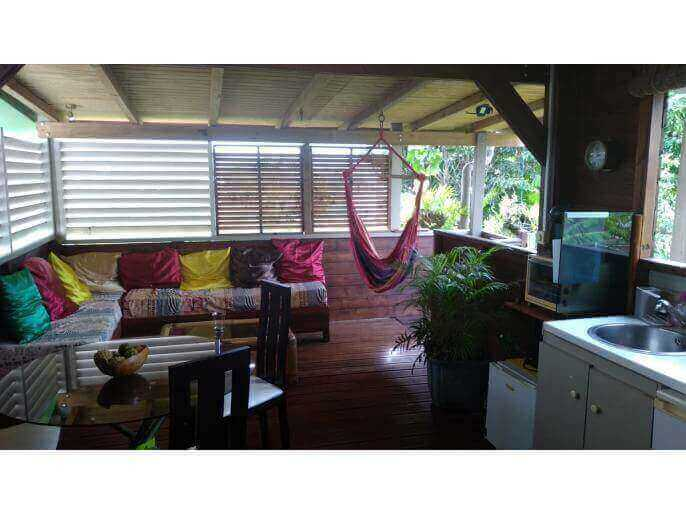 Location Maison/Appartement Guadeloupe - La terrasse de l'appartement à l'étage